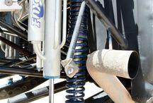 Trailing arm suspensions