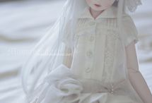 Dolls white   and. Sweets