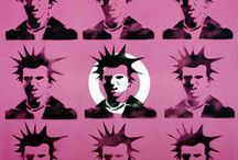 """Banksy and Rinaldo. Conceptual Art and Graffiti / The artist's world is as high as the imagination can soar and as low as it can tumble.  Come visit these posts which tell of two different artists.  One is """"real"""" and the other the figment of the imagination.  http://maryemartintrilogies.com/shock-awe-banksy/ Some say creativity is like a mental illness... If so, is it not a delightful madness? #graffiti #art #Banksy #Sid #Vicious"""
