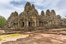 Prasat Bayon Temple / The Bayon (Prasat Bayon) is a well-known and richly decorated Khmer temple at Angkor in Cambodia. Built in the late 12th or early 13th century as the official state temple of the Mahayana Buddhist King Jayavarman VII, the Bayon stands at the centre of Jayavarman's capital, Angkor Thom. Following Jayavarman's death, it was modified and augmented by later Hindu and Theravada Buddhist kings in accordance with their own religious preferences.
