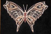 Q - motýľ
