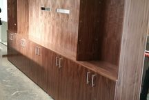 White and Walnut Media Rooms / 2 meeting rooms with storage and a media wall