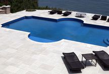 Pool Patios / For summer entertaining in a Long Island home, an outdoor swimming pool simply can't be beat. The possibilities are nearly endless, from poolside patios and living spaces to integrated waterfalls and luxury spas. No matter what kind of pool designs you may have in mind the or size or shape of your yard, Above All Masonry can help ensure your family has a beautiful and private oasis to enjoy all summer long—right in your own backyard.