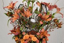 Unique Sympathy Arrangements / These themed and unique arrangements pay tribute to the person's personality, hobbies, and life.  We have made arrangements for Harley Davidson motorcycles, fishing, Broncos, golf, and many more.