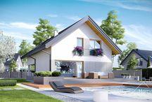 HomeKONCEPT 25 | Projekt domu / HomeKONCEPT-25 jest zawężoną wersją projektu HomeKONCEPT-12. Minimalna szerokość działki wymagana do realizacji tego domu wynosi jedynie 16.05 metra. Atrakcyjność tego domu wyraża się w jego prostocie i minimalizmie. Zwarta, klasyczna bryła skrywa w sobie szereg praktycznych rozwiązań. Spójna forma budynku o optymalnej powierzchni oraz nieskomplikowana konstrukcja dachu zdecydowanie ułatwią i przyspieszą realizację oraz nie obciążą znacznymi kosztami.