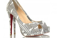 You will never be ugly if you have pretty shoes! / by Erin Muil
