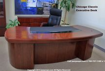 President's Desk - Chicago Classic / The beauty in this desk is in its curved wood design. This beautiful desk is for the executive who prefers not to have a side desk return section. This wood executive desk angles around the user. This high-end desk is ideal for the professional that wants enter their desk from either side. Includes a desktop data port. 5 sizes available.