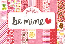 Be Mine / Send heartfelt thoughts and sentiments this Valentine's Day to all your favorite sweethearts. The newest collection from Pebbles Inc., Be Mine, focuses on sweet quotes, fun icons and bright images that everyone can enjoy. This line truly is for the young at heart and features simple, easy-to-use products that even the most novice crafter can use to create something stunning in just minutes. / by Pebbles Inc