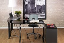 Calico Designs Modern Home Office by Studio Designs / These desks have sleek lines and are made of durable metal and glass.  These chairs are anything but your ordinary task chair. They will make a statement in your work space.