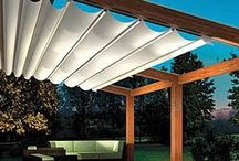 pergola with roof top covering.