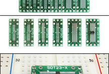 """Schmartboard SMT to DIP Adapters / This products are SOIC to DIP adapters with a Schmartboard twist. These have our patented """"ez"""" technology which means that soldering the surface mount component is simple, and as with all of our """"ez"""" boards, we are the only company with a patented solution for easily soldering surface mount parts."""