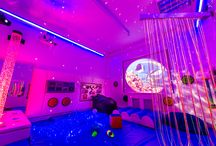 Sensory Room at 5 Senses / Incorporating Wall and Floor Padding, plus Interactive Bubble Tube with Plinth Switches - Fibre Optic Harness with LED Light Source - LED Opti-Kinetics Solar Projector - Mirror Ball System with LED Pinspot - Laser Star Projector - UV Fibre Optic Curtain on Swing Arm - Line Lite Mirror - UV Reactive Activity Panel - Tactile Discs - Softplay Mirror - Wall Mount Activity Board - Interactive Sound Panel - LED Colour Changing Mood Lights - Ceiling UV Lighting - Sensor Floor & furnishings.