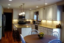 Dublin Kitchen Remodel / This Dublin Kitchen features maple cabinets, Jamestown door style, off white cabinets, Salazzo granite countertop, tile backsplash, under cabinet lighting, hardwood floors and crown molding.