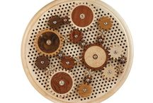 Cogs / These artful wooden gears can be arranged in different configurations on the matrix base.
