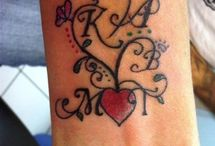 Tattoos & Piercings / by Paula Tillett