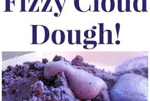 Making fizzy cloud dough with drops of vinegar