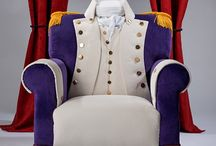 The Show-Stopping Hamilton / Lovingly upholstered in a decadent velvet, this quirky handmade, deep seated armchair rests on blackened Vintage ball and claw feet. Inspired by the upcoming musical, this show-stopping 'Hamilton' chair is an eclectic mix of Royal Purple and Ivory velvet with brass blazer buttons to waistcoat, jacket and cuffs, with tan leather boot top detail to front legs.