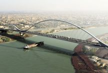 Al-Graia / Al Graia, design proposals  Dissing+Weitling has in collaboration with Schlaich bergermann und partner from Stuttgart designed two proposals for the crossing of Tigris in Baghdad for the client NRS-Asia.  The design includes a double arched bridge and a single pylon suspension bridge.