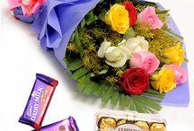 Flowers and Chocolates / Explore the combo of flowers and chocolates. Flower Bouquets with Ferrero Rocher , Cadbury Celebrations.