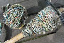 Handspun paper yarn, own work  Käsinkehrättyä paperilankaa / Kehrään värttinällä erilaisista papereista lankaa  I use a spindel to spin yarn out of various papers