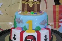 """Pirate Birthday Party / Baby's First Pirate Birthday Party!  A birthday party where Mom went """"overboard"""" putting together a massive feast for her baby boy.  A massive, 40+ pound cake, baby smash cake, pirate ship cake pops, pirate chocolate lollipops and a feast fit for any pirate!"""