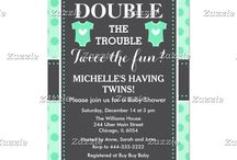 Double Trouble Green Polka Dots Twins Baby Shower / This design features two baby outfits in green with a white heart in the center. The background is green polka dots and a gray chalkboard with a dotted border.
