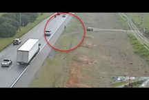 Viral Video - VIDEO - Brazilian Cop Parks the Car on Side of Highway and Then Dives Under Passing Truck