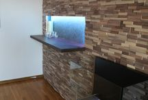 Our Project January 2015 / Our Swedish customer used Striped - Walnut - Narrow - Split - Natural panels for this project. These photos prove how easy to cut and use our panels if you want built in shelves or TV.