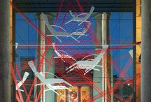 Tecno connecting strings / A continuous, red sign finds its way into Tecno's Caselli, drawing a net of spatial links, defined by more than 1 km of stiff, red strips.