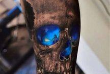 Татуировка стилизованные черепа
