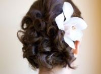 Up-do's with flowers / There is a floral accessory to suit all kinds of brides and wedding styles. From rustic to glam, vintage to modern and everything in between.  Small flowers make a fabulous addition to a wide variety of 'hair up' styles!! Get inspired with our work   Styling Trio Riviera Maya FABULOUS from Beginning to End!