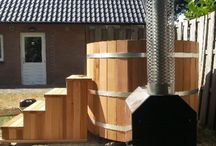 Cedar Hot Tubs  / Cedar Wood-Burning Hot Tubs - Hot, wood heated water massages your aches and pains, accompanied by the scent of cedar and in the style of classic Japanese bathing.