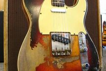 Lovely battered guitars / by Jamie Doyle