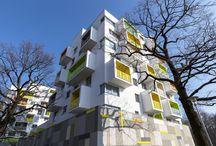 Nový háj / Základom bol silný architektonický koncept, ktorý umožňoval klientom prispôsobiť si na mieru interiér aj exteriér bytu. Bytový dom Nový háj bol ocenený cenou za najlepšiu slovenskú architektúru CEZAAR 2015.