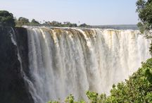 Zimbabwe / Zimbabwe is a landlocked country in southern Africa known for its dramatic landscape and diverse wildlife, much of it within parks, reserves and safari areas. On the Zambezi River, Victoria Falls make a thundering 108m drop into narrow Batoka Gorge.