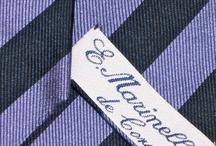 """Marinella / La produzione firmata E.Marinella ha conservato la scrupolosa attenzione alla qualità delle materie prime e la curatissima fattura ancora oggi rigorosamente artigianale, per queste cravatte """"napoletane veraci"""" e allo stesso tempo """"very british""""."""