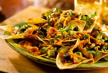 Not Your Ordinary Nachos / Nachos are not just chips with cheese sauce on them anymore. They are pretty much anything you can imagine stacked on apples, chips, etc. So many that I would like to try. / by Anita Self