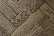 Herringbone Floors & Walls / The herringbone pattern is an arrangement of rectangles, so named for a fancied resemblance to the bones of a fish such as a herring.