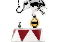 ALESSI Circus / From the beginning, Designer Marcel Wanders and Creative Director Gabriel Chiave envisioned the concept as thoroughly borrowing from the historical, unexpected symbols of the circus, while at the same time, their goal was to create collectible heirlooms. The Circus Collection by Alessi includes plates and trays made of steel, ceramic bowls and mugs, along with tin and glass storage containers.