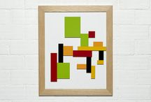 De Stijl-inspired Magnetic Painting / Build your own De Stijl - inspired work of art by using our magnetic painting.   Each piece is covered with formica on top and bears magnets underneath that attach it to the magnetic surface.  Hang the frame on the wall, either vertically or horizontally, or simply put it on the table or floor for kids to experiment.  Build anthropomorphic figures or abstract works of art and rearrange them at will. Add or remove coloured pieces till you reach the intended result.