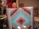 """Quilting classes at Jenny's Sewing Studio / Jenny's Sewing Studio teaches Quick Trip, Log Cabin, Radiant Star, Free motion stippling, and we have recently added the """"Braid in a Day"""" class. One block classes include Sun Bonnet Sue and Heart and Bunny applique"""