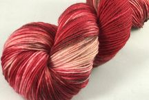 Warm Up Those Feet / Who doesn't love knitted socks? There is something extra special about slipping on a pair of warm wooly socks. Our hand dyed sock yarn skeins are made of superwash wool and nylon, capable of standing up to the toughest feet around.