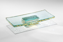 Slabs / Annieglass' thickest collection, weighty slabs of half-inch clear glass with either a plain or precious metal edge add a note of modern sophistication to any table. The Annieglass Slab Collection provides great versatility, and is especially stunning as cheese platters or for serving sushi.