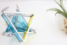 """hanging glass / handmade glass atelier Offrir Offrir creates small goods and accessories made of glass by using techniques of kiln-glass fusing and stained glass. My concept is """"having a pleasant life through comfortable textures and colors of glass"""". I take utmost care in designing the color tones inspired by nature scenes and being creative in deciding the color combinations."""