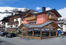 Hotel B&B Champagne Livigno / Hotel Champagne Cozy three star hotel decorated in traditional Alpine style in a beautiful sunny location just steps from the pedestrian area of Livigno. treatment of bed and breakfast with extensive breakfast buffet. the rooms