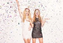 Confetti Party / Shoot in a studio or on white / plain wall.  on camera flash look - ready to party, a night on the town. bold lip, smokey eye. hair down, curly or straight.  fashion - cute/ sexy out fit, something you would wear out on a night out.  Glitter, streamers, tinsel, party poppers.  bright, colorful, happy exciting!