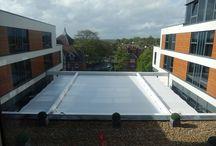Radisson Blu Hotel UK / Retractable Fabric Structure using SEFAR Tenara Fabric 4T40HF in Guildford/UK