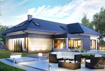 HomeKONCEPT 14 | Projekt domu / HomeKONCEPT-14 to dom pełen elegancji. Z zewnątrz wyróżnia go elewacja wykończona piaskowcem  oraz kompozycją białego i szarego tynku. Takie zestawienie połączone z pokryciem dachowym w kolorze grafitu oraz unikalnym, geometrycznym detalem z pewnością przyciąga uwagę.