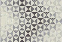 grey quilts