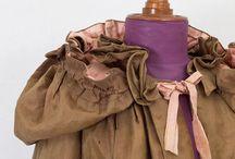 Cloaks, capes, coats and wraps